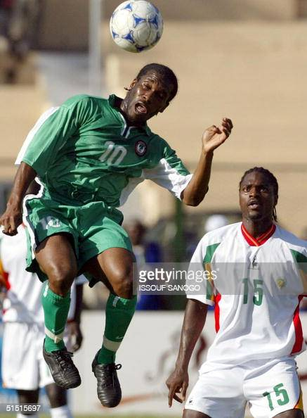 Nigerian striker Augustine Okocha Augustine fights for the ball with two unidentified Senegalese players 07 February 2002 in Bamako during the semi...
