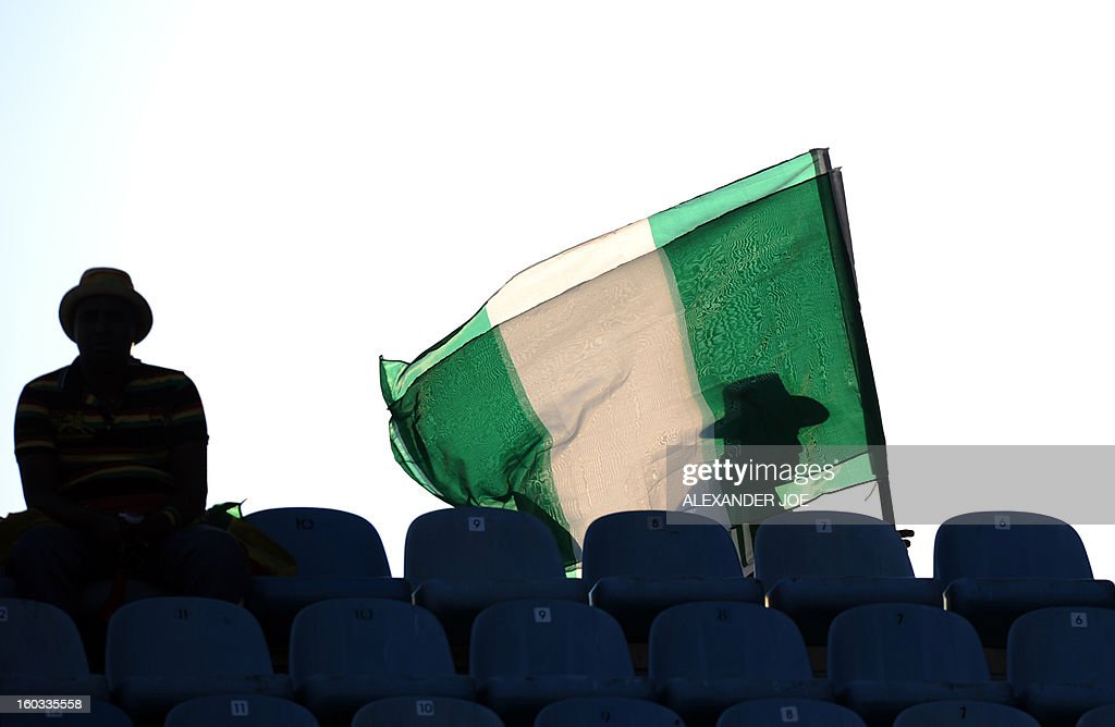 A Nigerian supporter walks with his flag before the match against Ethiopia during the 2013 Africa Cup of Nations Group C match at Royal Bafokeng Stadium in Rustenburg on January 29, 2013. AFP PHOTO / ALEXANDER JOE