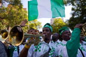 Nigerian supporters carrying a national flag parade through Johannesburg with drums and trumpets toward the Ellis park stadium where the 2010...