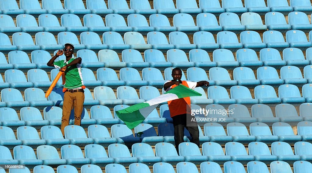 Nigerian supporters wave a flag before the match against Ethiopia during the 2013 Africa Cup of Nations Group C match at Royal Bafokeng Stadium in Rustenburg on January 29, 2013. AFP PHOTO / ALEXANDER JOE