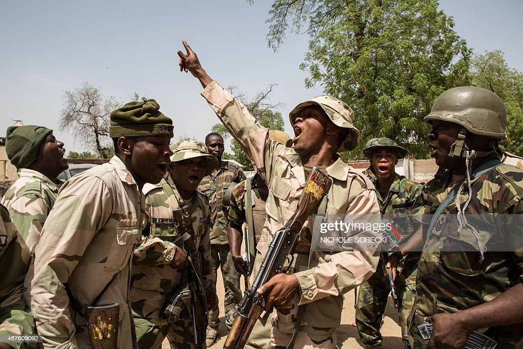 Nigerian troops celebrate after taking over Bama from Boko Haram on March 25 2015 Nigeria's military has retaken the northeastern town of Bama from...