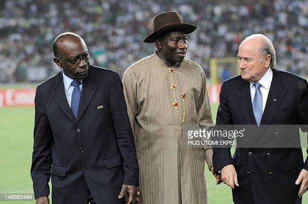 Nigerian Vice President Goodluck Ebele Jonathan flanked by FIFA's President Sepp Blatter and Vice President Jack Warner looks on during the final of...