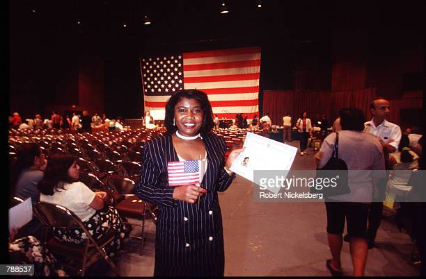 A Nigerian woman holds her citizenship certificate September 25 1999 in Miami FL Three thousand people attended the swearing in ceremony and took the...