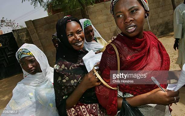 Nigerian women working as doortodoor innoculators pause while canvassing an urban neighborhood during a nationwide polio innoculation April 12 the...