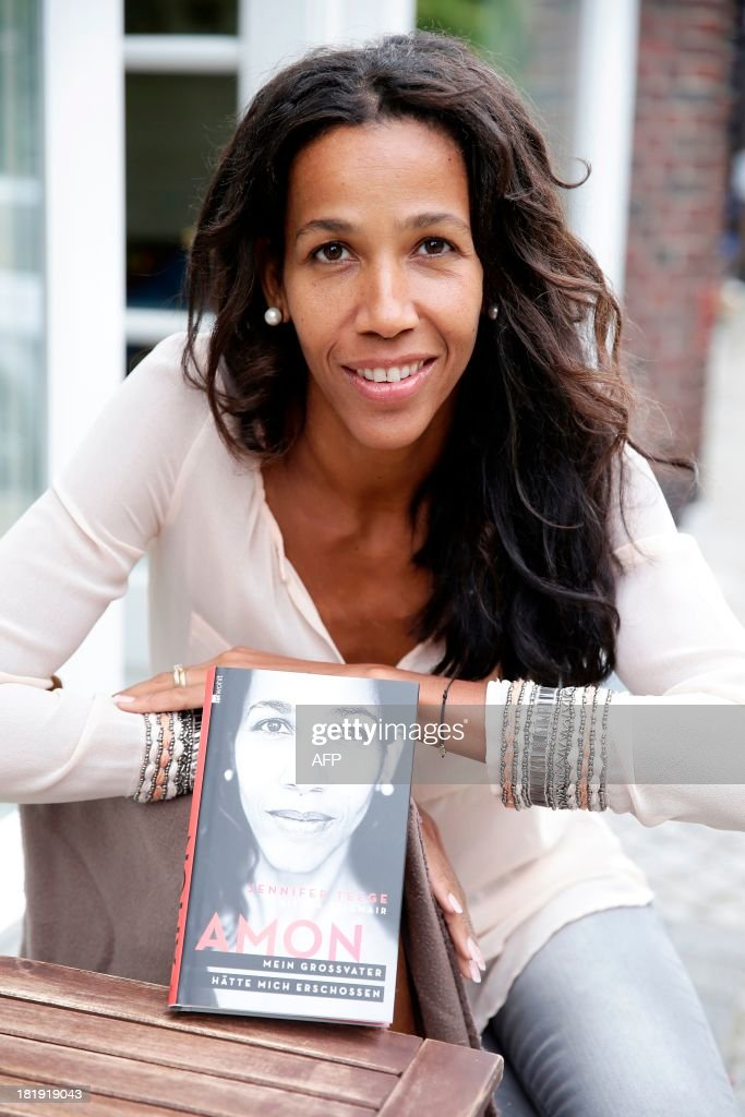 Nigerian-German Author Jennifer Teege poses for a photo with her book 'Amon, My grandfather would have shot me' (Mein Grossvater haette mich erschossen) about concentration camp commander Amon Goeth in Hamburg, northern Germany on September 26, 2013.