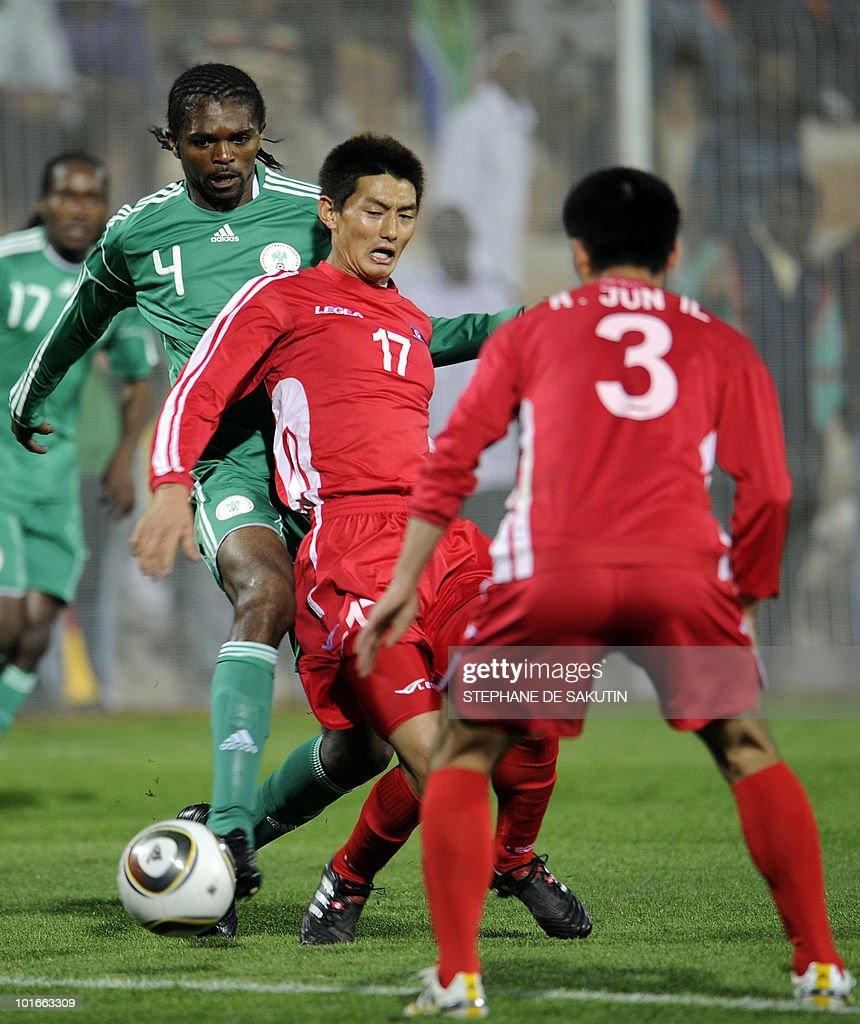 Nigerian's player Nwankwo Kanu (L) fights for the ball with North Korean's An Young-Hak (C) during their international friendly football match at Makhulong stadium on June 6, 2010 in Tembisa . The 2010 FIFA World Cup football championship is due to take place in South Africa from June 11 to July 11 of 2010.