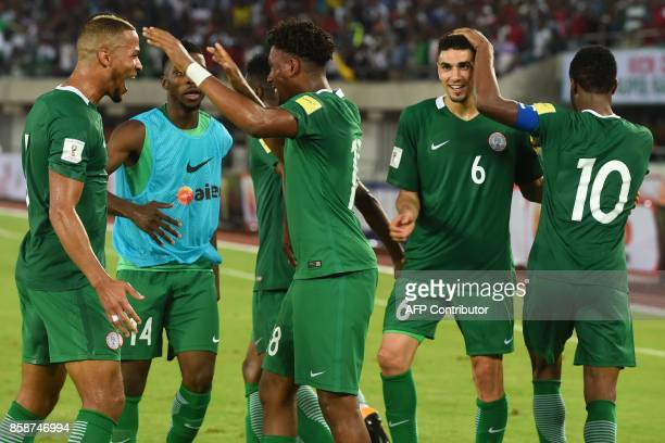 Nigeria's Alex Iwobi celebrates with teammates after scoring during the FIFA World Cup 2018 qualifying football match between Nigeria and Zambia in...