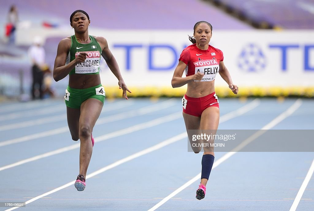 Nigeria's Blessing Okagbare (L) and US Allyson Felix compete during the women's 200 metres semi-final the 2013 IAAF World Championships at the Luzhniki stadium in Moscow on August 15, 2013.