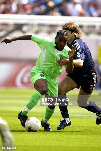 Nigeria's captain Jay Jay Okocha and Argentina's Gabriel Batistuta battle for the ball