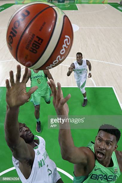 Nigeria's centre Ekene Ibekwe and Brazil's shooting guard Leandro Barbosa go for a rebound during a Men's round Group B basketball match between...