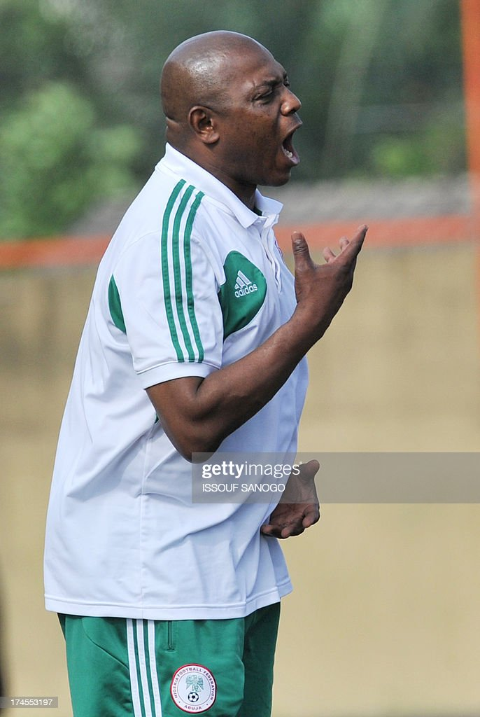 Nigeria's coach Stephan Keshi reacts during the 2014 African Nations Championship (CHAN) qualifying football match between Ivory Coast and Nigeria on July 27, 2013 at the Robert-Champroux Stadium in Abidjan. Ivory Coast defeated Nigeria 2 - 0.