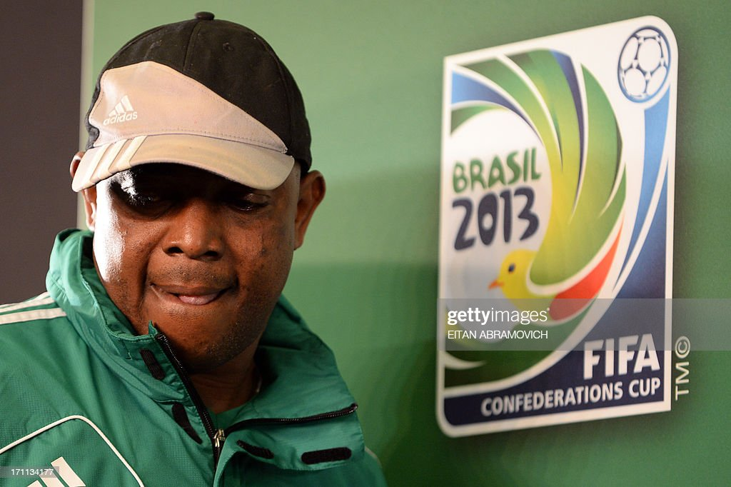 Nigeria's coach <a gi-track='captionPersonalityLinkClicked' href=/galleries/search?phrase=Stephen+Keshi&family=editorial&specificpeople=774165 ng-click='$event.stopPropagation()'>Stephen Keshi</a> arrives for a press conference in Fortaleza, Brazil on June 22, 2013. Nigeria will face Spain in their FIFA 2013 Confederation Cup football match next June 23. AFP PHOTO/Eitan Abramovich