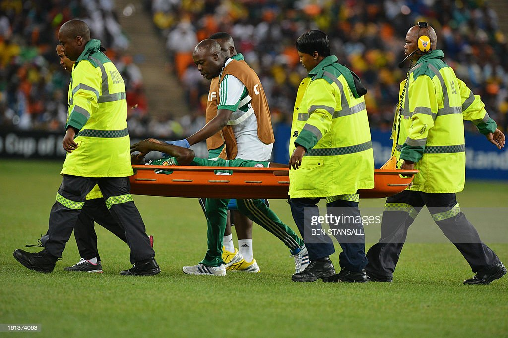 Nigeria's defender Elderson Echiejile leaves the pitch on a stretcher after sustaining an injury during the 2013 African Cup of Nations final football match between Burkina Faso and Nigeria on February 10, 2013 at Soccer City stadium in Johannesburg.