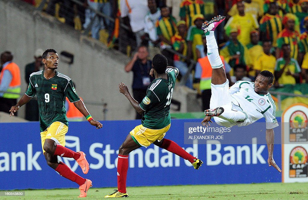 Nigeria's defender Godfrey Oboabona vies with Ethiopia's forward Getaneh Kebede (L) and Ethiopia's forward Fuad Ibrahim (C) during the 2013 Africa Cup of Nations Group C match at the Royal Bafokeng Stadium in Rustenburg on January 29, 2013.