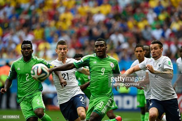 Nigeria's defender Joseph Yobo and Nigeria's forward Emmanuel Emenike vie for the ball with France's defender Laurent Koscielny and France's defender...