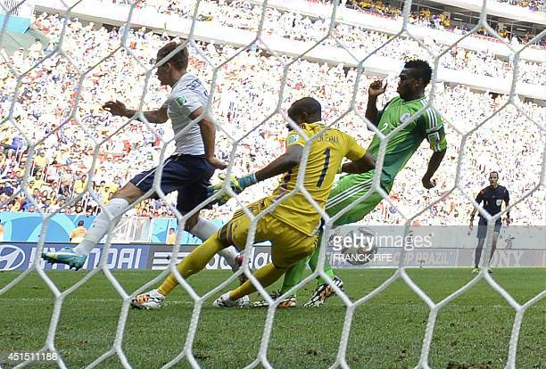 Nigeria's defender Joseph Yobo scores an own goal while challenging France's forward Antoine Griezmann during the round of 16 football match between...