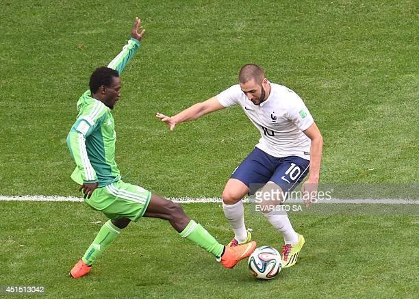 Nigeria's defender Juwon Oshaniwa vies with France's forward Karim Benzema during a Round of 16 football match between France and Nigeria at Mane...