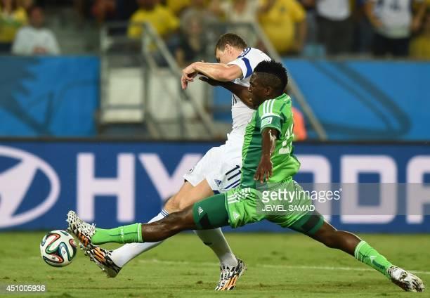 Nigeria's defender Kenneth Omeruo challenges BosniaHercegovina's midfielder Zvjezdan Misimovic during the Group F football match between Nigeria and...