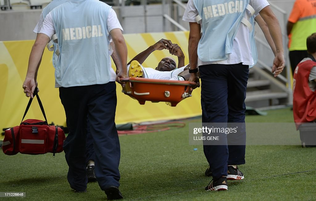 Nigeria's defender Kenneth Omeruo is carried on a stretcher during the FIFA Confederations Cup Brazil 2013 Group B football match against Spain, at the Castelao Stadium in Fortaleza on June 23, 2013.