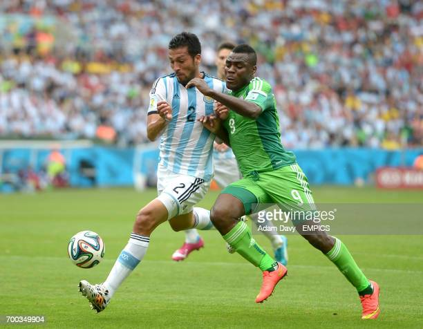 Nigeria's Emmanuel Emenike and Argentina's Ezequiel Garay battle for the ball