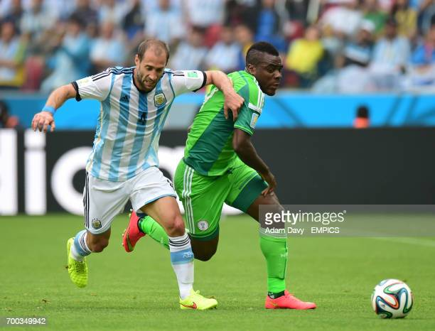 Nigeria's Emmanuel Emenike and Argentina's Pablo Zabaleta battle for the ball