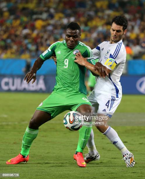 Nigeria's Emmanuel Emenike and Bosnia Herzegovina's Emir Spahic battle for the ball