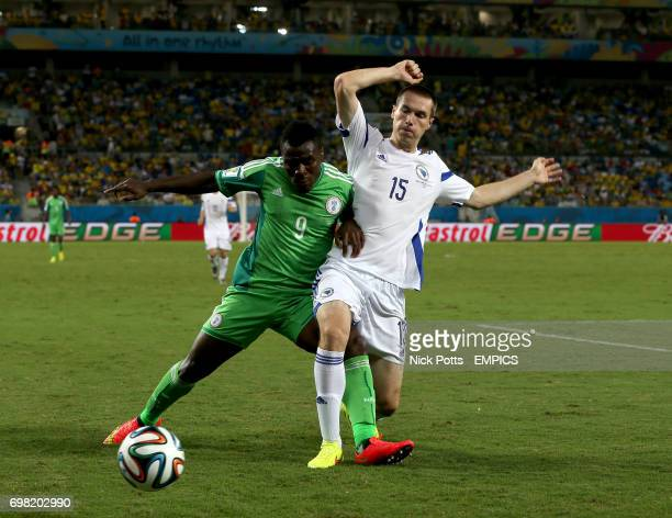 Nigeria's Emmanuel Emenike and Bosnia Herzegovina's Toni Sunjic battle for the ball