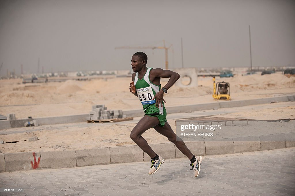 Nigeria's Emmanuel Gyang competes in the first Lagos City Marathon, on February 6, 2016 in Lagos. / AFP / STEFAN HEUNIS