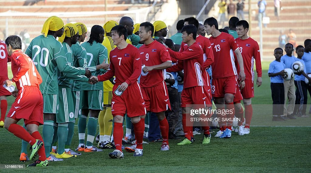 Nigeria's football team (L) and North Korea's football team (R) greet each other prior their international friendly football match at Makhulong stadium on June 6, 2010 in Tembisa . The 2010 FIFA World Cup football championship is due to take place in South Africa from June 11 to July 11 of 2010.