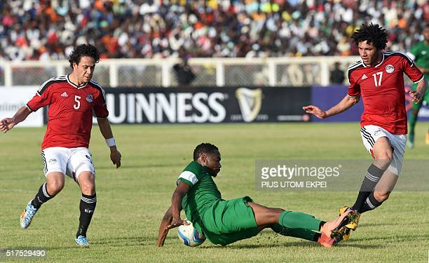 Nigeria's forward Ahmed Musa falls on the ball during the African Cup of Nations qualification match between Egypt and Nigeria on March 25 in Kaduna...