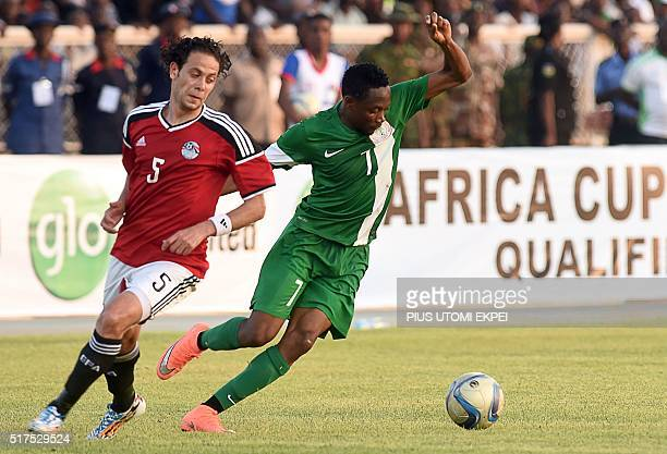 Nigeria's forward Ahmed Musa vies with Egypt's defender Ibrahim Salah during the African Cup of Nations qualification match between Egypt and Nigeria...