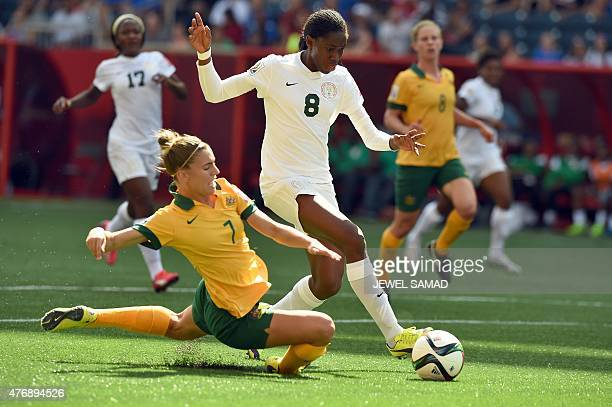 Nigeria's forward Asisat Oshoala is challenged by Australia's defender Steph Catley during their Group D match of the 2015 FIFA Women's World Cup at...
