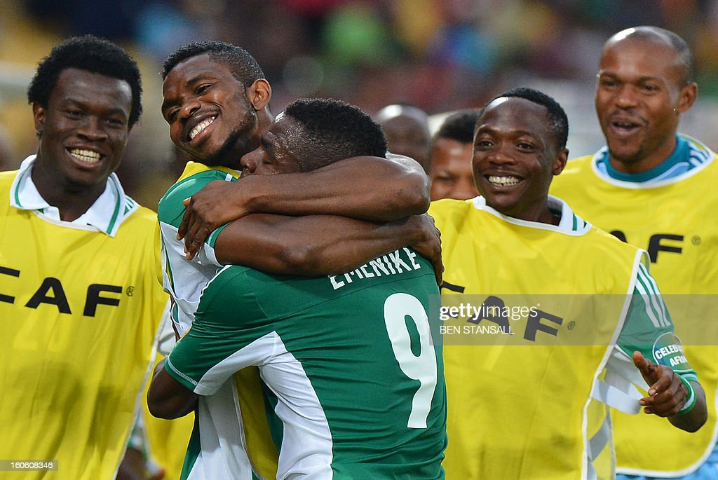 Nigeria's forward Emmanuel Emenike (C) is congratulated by teammates after scoring a goal during the African Cup of Nation 2013 quarter final football match Ivory Coast vs Nigeria, on February 3, 2013 in Rustenburg. AFP PHOTO / BEN STANSALL