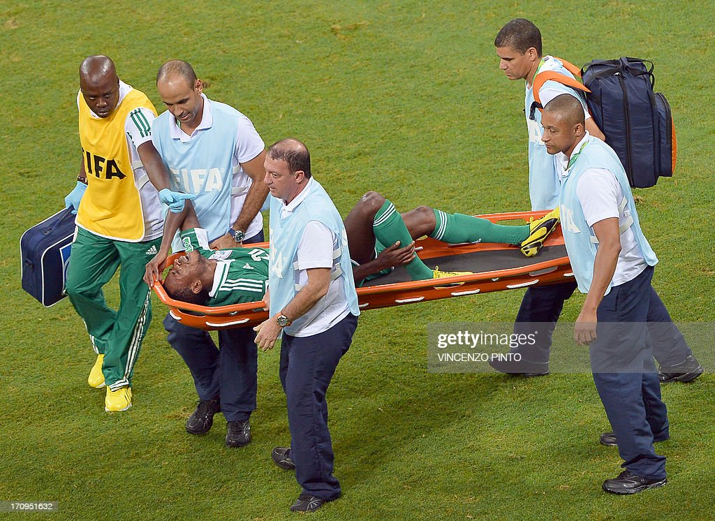 Nigeria's forward Nnamdi Oduamadi is carried on a stretcher during the FIFA Confederations Cup Brazil 2013 Group B football match against Uruguay, at the Fonte Nova Arena in Salvador, on June 20, 2013.