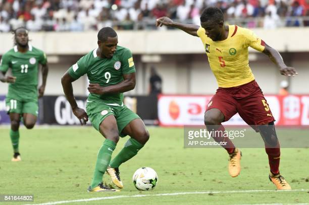 Nigeria's forward Odion Ighalo vies with Cameroon's defender Michael Ngadeu during the 2018 FIFA World Cup qualifying football match between Nigeria...