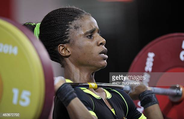 Nigeria's gold medalist Chika Amalaha competing in the women's weightlifting 53kg class at the SECC Precinct during the 2014 Commonwealth Games in...