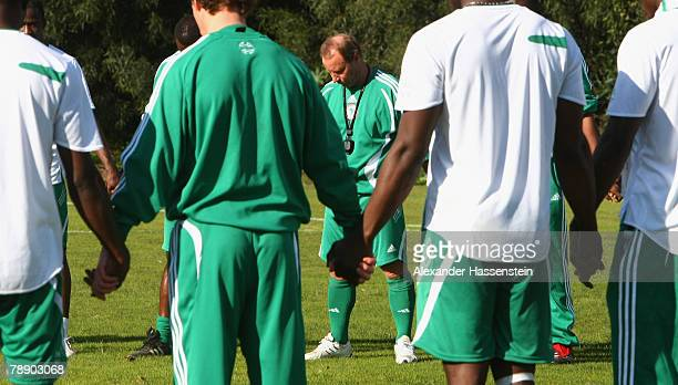 Nigerias head coach Berti Vogts prays with his players after the Nigeria national soccer team training session on January 11 2007 in Marbella Spain
