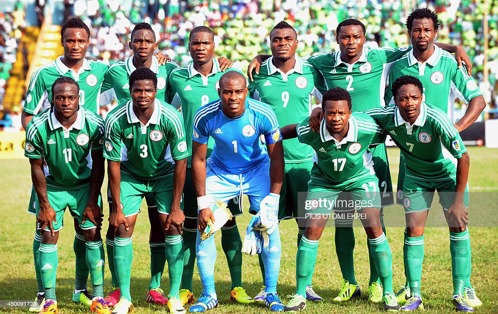 Nigeria's (top L-R) midfielder John Obi Mikel, defender Kenneth Omeruo, forward Brown Ideye, forward Emmanuel Emenike, defender Godfrey Oboabona, defender Efe Ambrose, (bottom L-R) midfielder Victor Moses, defender Uwa Echiejile, goalkeeper Vincent Enyeama, midfielder Ogenyi Onazi and midfielder Ahmed Musa pose for a group picture before the 2014 FIFA World Cup African zone second leg play-off football match between Nigeria and Ethiopia in Calabar on November 16, 2013. Nigeria won 2-0.