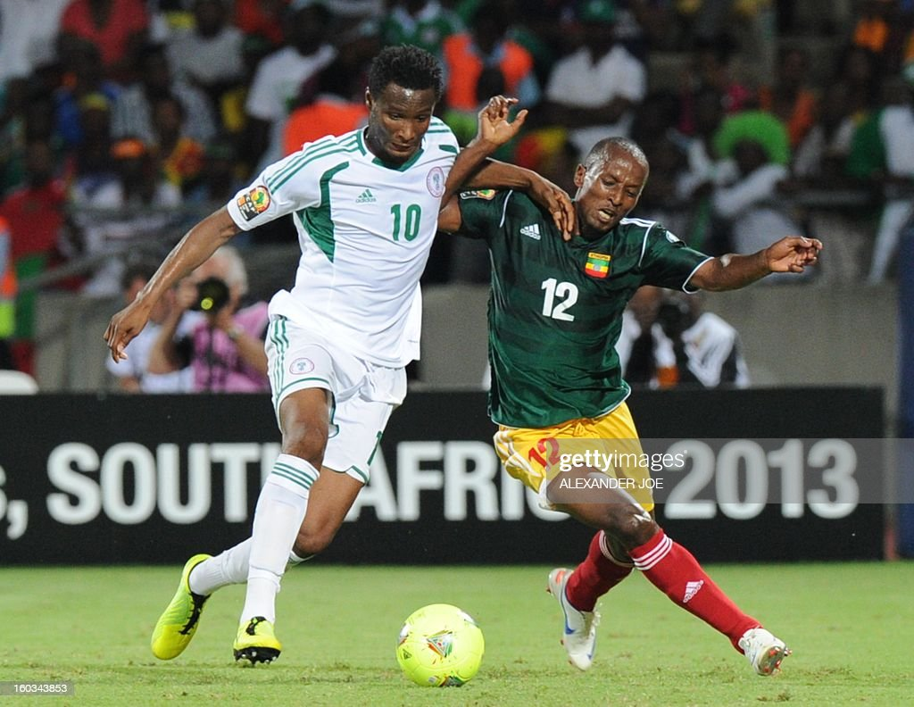 Nigeria's midfielder John Obi Mikel vies with Ethiopia's defender Biyadiglign Eliase during the 2013 Africa Cup of Nations Group C match at Royal Bafokeng stadium in Rustenburg on January 29, 2013. AFP PHOTO / ALEXANDER JOE