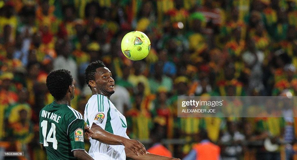 Nigeria's midfielder John Obi Mikel vies with Ethiopia's midfielder Minyahile Teshome during a 2013 Africa Cup of Nations Group C match at Royal Bafokeng stadium in Rustenburg on January 29, 2013.