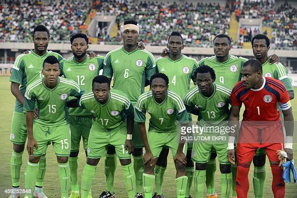 Nigeria's national football team players pose before the 2015 Africa Cup of Nations qualifying football match between Nigeria and South Africa at...