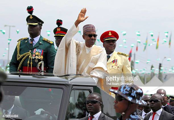 Nigeria's new President Muhammadu Buhari greets the audience during his swearing in on May 29 2015 in Abuja Nigeria Buhari a former general in the...