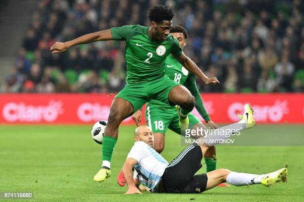 Nigeria's Ola Aina and Argentina's Javier Mascherano vie for the ball during an international friendly football match between Argentina and Nigeria...