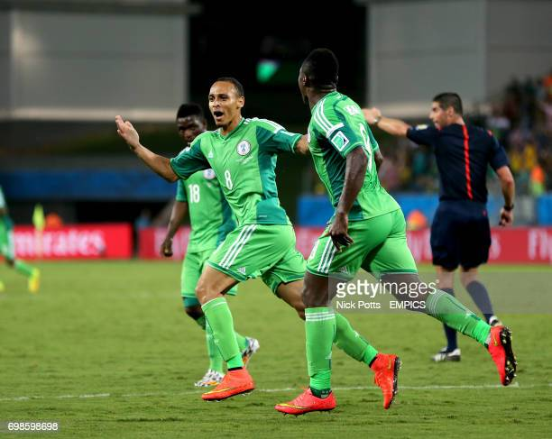 Nigeria's Peter Odemwingie celebrates scoring his teams opening goal alongside teammate Emmanuel Emenike