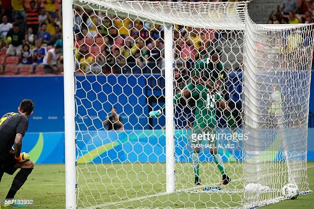 Nigeria's player Mikel celebrates with teammate Sadiq after the latter scored past Sweden's goalkeeper Andreas Linde during their Rio 2016 Olympic...