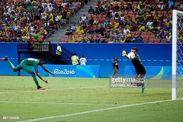Nigeria's player Sadiq scores past Sweden's goalkeeper Andreas Linde during their Rio 2016 Olympic Games Men's First Round Group B match at the Arena...