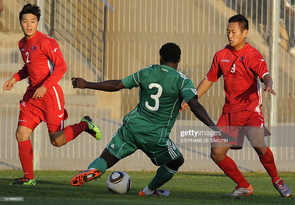 Nigeria's player Taye Taiwo (C) fights for the ball with North Korea's players Cha Jong-Hyok (L) and Jong Tae-se (R) during their international friendly football match at Makhulong stadium on June 6, 2010 in Tembisa . The 2010 FIFA World Cup football championship is due to take place in South Africa from June 11 to July 11 of 2010.