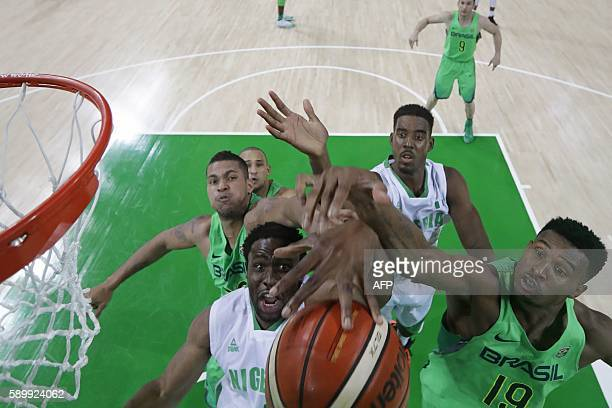 Nigeria's power forward Ike Diogu and Brazil's shooting guard Leandro Barbosa go for a rebound during a Men's round Group B basketball match between...