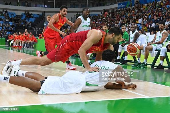 Nigeria's power forward Ike Diogu and Spain's power forward Felipe Reyes fall during a Men's round Group B basketball match between Nigeria and Spain...