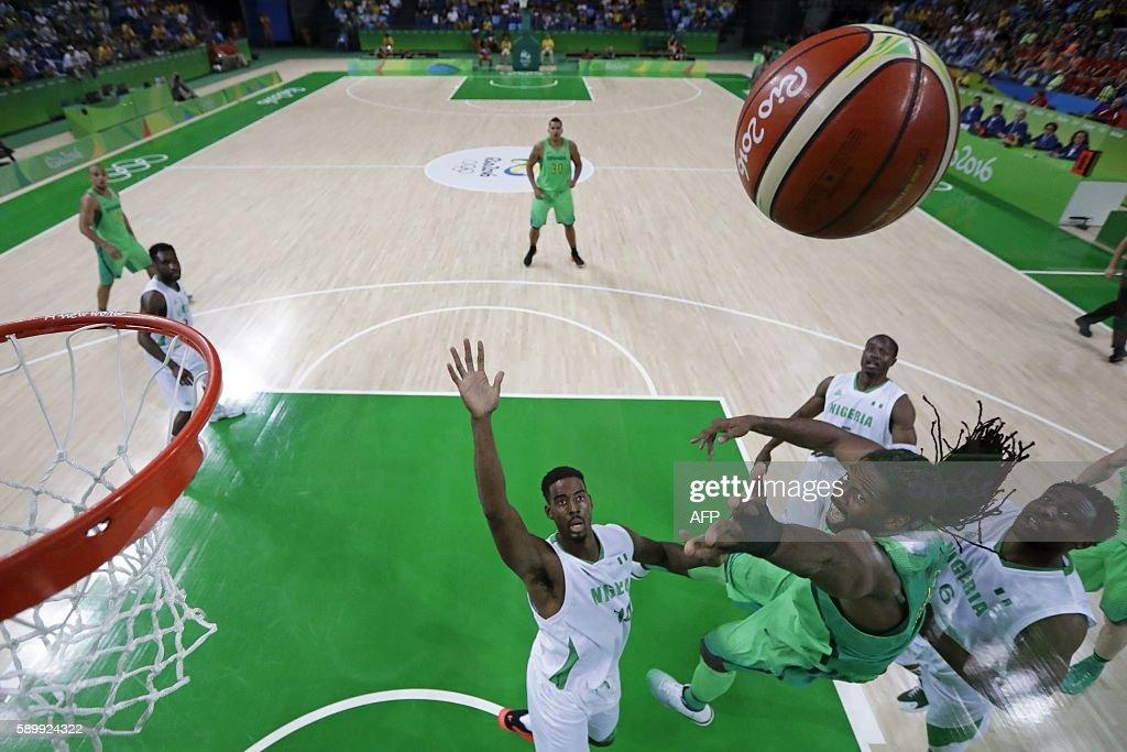 Nigeria's power forward Ike Diogu Brazil's centre Nene Hilario and Nigeria's power forward Alade Aminu eye a rebound during a Men's round Group B...